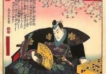 Hatakeyama sitting next to a Go board 1845